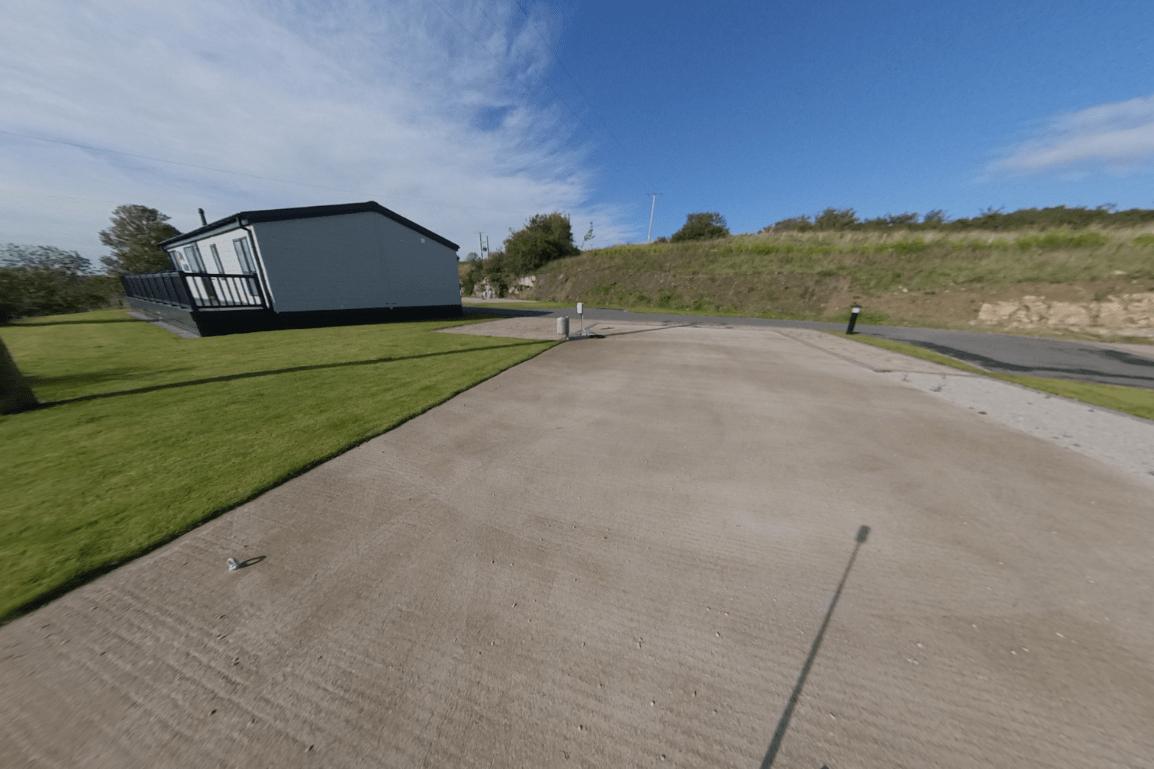 Last lodge plot on Bryn Defaid Lodge and Caravan Park nr Abergele, North Wales - view behind
